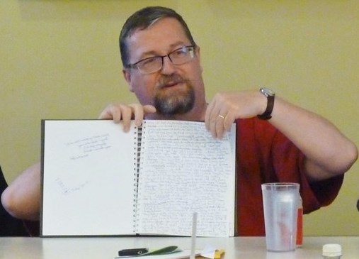 Andy Duncan with his writing notebook
