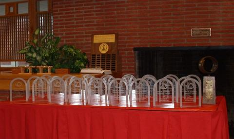 Campbell Award (on right) and trophies.  SF&F Hall of Fame Award and plaque are in the background